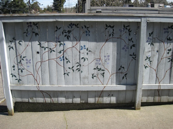 a Clematis mural on a fence in Seattle